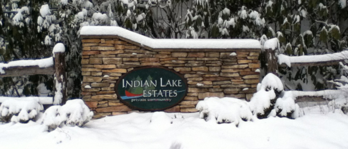 Indian Lake Estates sign in the snow